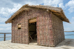 Reed House. Build on lake Royalty Free Stock Image