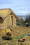 Reed House on Floating Island. This image was shot on the Floating Reed Islands of Lake Titicaca near Puno, Peru Royalty Free Stock Images