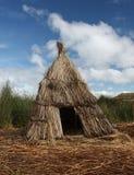Reed hut on Lake Titicaca, Peru. Reed hut on the floating islands of Lake Titicaca in Peru stock photo