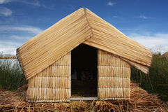 Reed hut on Lake Titicaca, Peru. Reed hut on the floating islands of Lake Titicaca in Peru stock images