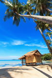 Reed huts and coconut palms. On the sandy beach. Beautiful sea landscape Royalty Free Stock Photos