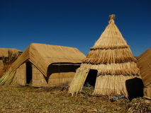 Reed huts at Lake Titicaca. The pre-Incan Aymara people of the Uros Islands on Lake Titicaca in Peru have a heavy reliance on reeds for their existence Stock Images