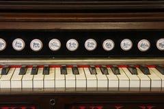 Reed organ keyboard. Close up of reed organ keyboard and stops Royalty Free Stock Photography