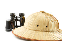 Reed safari hat and binoculars Stock Images