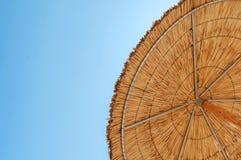Reed umbrellas beach on the beach against blue sky Royalty Free Stock Photography