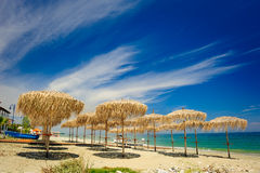 Reed umbrellas on the beach Royalty Free Stock Photo