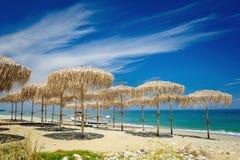 Reed umbrellas on the beach Stock Photo
