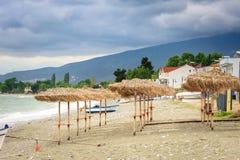 Reed umbrellas on the beach Stock Image