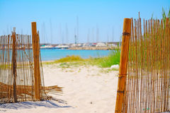 Reeds fence at beach entrance in Alghero Stock Images