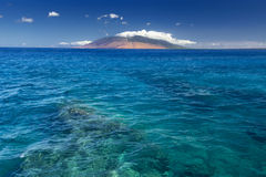 Reef in clear water with view of West Maui Mountains from south shore. Maui, Hawaii, USA. Clear water with view of West Maui Mountains from south shore. Maui royalty free stock photos