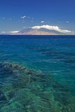 Reef in clear water with view of West Maui Mountains from south shore. Maui, Hawaii, USA. Clear water with view of West Maui Mountains from south shore. Maui stock photography