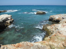 Reef Crete Greece. Rocky sea reef at Star Beach in limenas Chersonissos, Crete, Greece Stock Photos