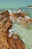 Reef extend on beach. Reef on beach extend to sea, within blue water and white yellow sand Royalty Free Stock Photo