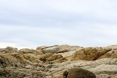 Reef is a group of rocks a ridge of sand and blue sky background. Reef is a group of rocks or coral or a ridge of sand at near water surface blue sky background royalty free stock photos