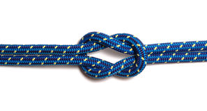 Reef Knot. Made of two blue-yellow hawsers, isolated stock photo