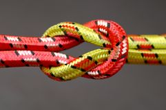 Reef knot. Isolated over dark background Stock Photo