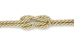 Reef knot in golden ropes Stock Images