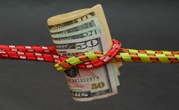 Reef knot and money Royalty Free Stock Images