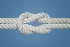 Reef Knot or Square Knot. The Reef Knot or Square Knot is quick and easy to tie; it is a good knot for securing non-critical items. This knot was used for Stock Image