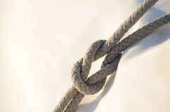 Reef knot or square knot, it was used by sailors for reefing sai Royalty Free Stock Photos