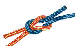 Reef knot, yellow and blue ropes. Royalty Free Stock Photos