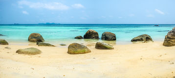 Reef rock sort. On white sand blue emerald sea,panorama Stock Photos
