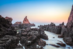 Reef rock in sunrise Royalty Free Stock Image