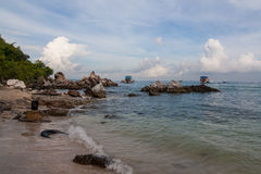 Reef. Rocks by the sea in the morning Royalty Free Stock Photo