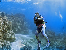 ReefDiver. Divers exploring coral reef Stock Photos