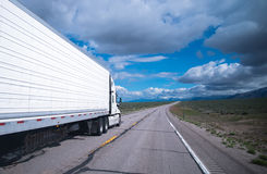 Reefer semi trailer rig going to horizon in Arizona Royalty Free Stock Photo