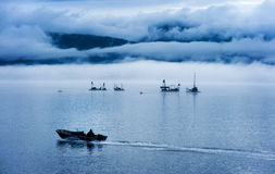 Reefnet Salmon Fishermen on a Foggy Day. Pacific salmon fishermen off of Lummi Island in the Puget Sound area of Washington State. Reefnetting is an old Indian Royalty Free Stock Photo