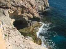 Reefs. Cliffs on the coast of the Malorca Island southeast Stock Photos