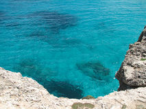 Reefs. Cliffs on the coast of the Malorca Island southeast Royalty Free Stock Images
