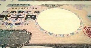 Reeks bankbiljetten van twee duizend Yen Japanner die van de bank van Japan, lijn rollen stock video