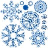 Reeks blauwe bloemencirkelpatronen Stock Afbeeldingen