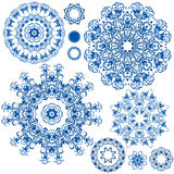 Reeks blauwe bloemencirkelpatronen Achtergrond in de stijl Stock Afbeelding