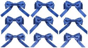 Reeks blauwe die satijnbogen op wit worden geïsoleerd Royalty-vrije Stock Fotografie