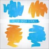 Reeks blauwe en oranje vectorborstelslagen Stock Afbeelding