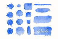 Reeks blauwe waterverfvlekken en vlekken Stock Foto's