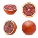 Reeks bloedige sinaasappelen met blad op witte achtergrond Royalty-vrije Stock Foto