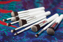 Reeks borstels voor make-up op bohoachtergrond Royalty-vrije Stock Foto's