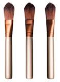 Reeks bruine zachte kosmetische borstels in verschillende lichte voorwaarden Royalty-vrije Stock Fotografie
