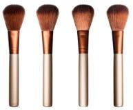 Reeks bruine zachte kosmetische borstels in verschillende lichte voorwaarden Stock Afbeeldingen