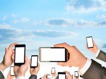 Reeks die handen mobiles houden royalty-vrije stock fotografie