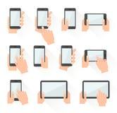 Reeks die handen slimme telefoons houden Stock Afbeeldingen