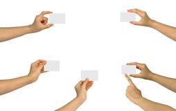 Reeks die van hand een leeg adreskaartje houdt stock foto's