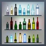 Reeks gekleurde flessen Stock Afbeeldingen