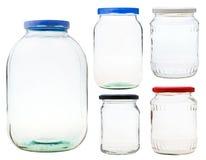 Reeks gesloten die glaskruiken op wit wordt geïsoleerd Stock Foto's
