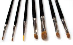 Reeks geïsoleerdee make-upborstels Stock Afbeeldingen