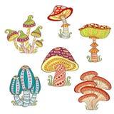 Reeks gestileerde sier kleurrijke paddestoelen royalty-vrije illustratie